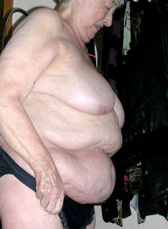Alluring Granny Displays Her Fat Body As She Pose Naked And Expose Her Juicy Breasts Before She